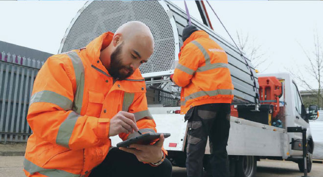 A Cyclehoop employee using JobWatch from a tablet