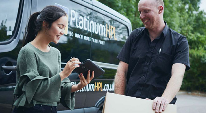 Platinum HPL Employee using a tablet to manager their day utilising the JobWatch platform