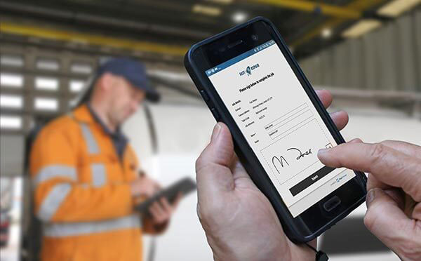 BigChange uses no touch signatures employee holding mobile device