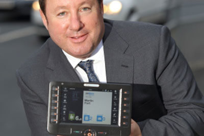Martin Port holding a mobile device