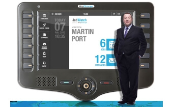 Martin Port, CEO in front of a tablet running JobWatch software