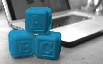 ABC dice next to a computer