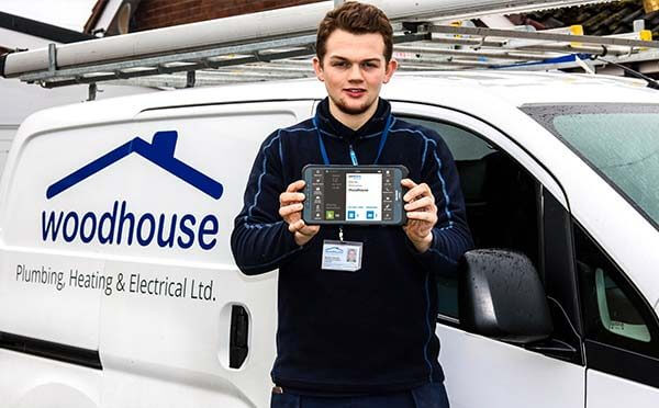 Woodhouse employee with a BigChange tablet