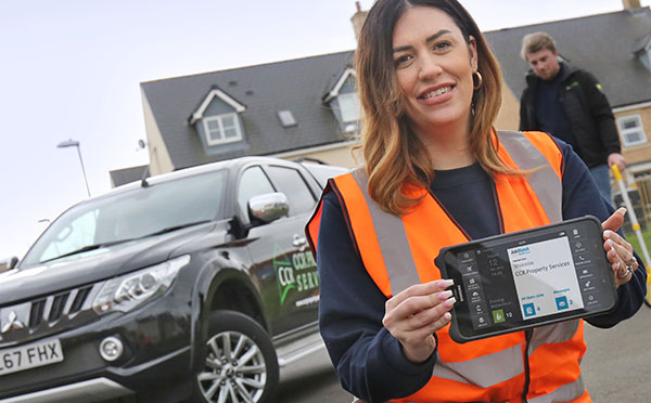 CCR Employee holding a JobWatch Mobile device