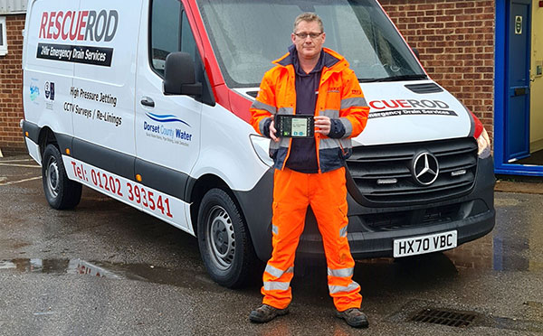 Rescue Rod employee holding a Jobwatch mobile device