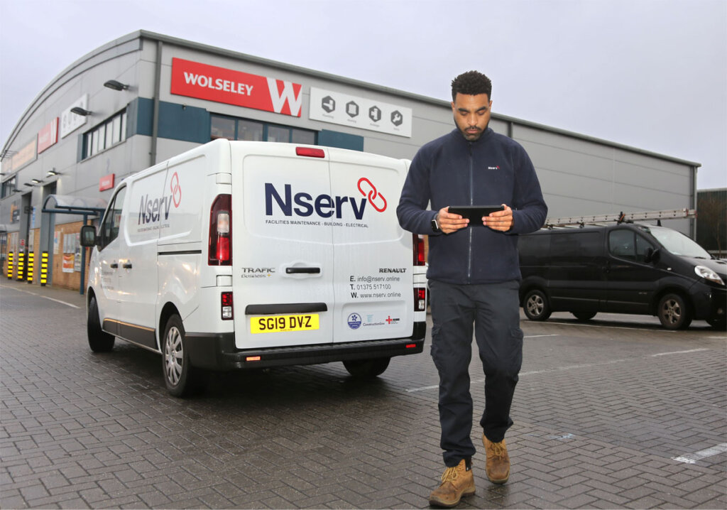 Nserv employee using a BigChange mobile device to increase is organise his workflow