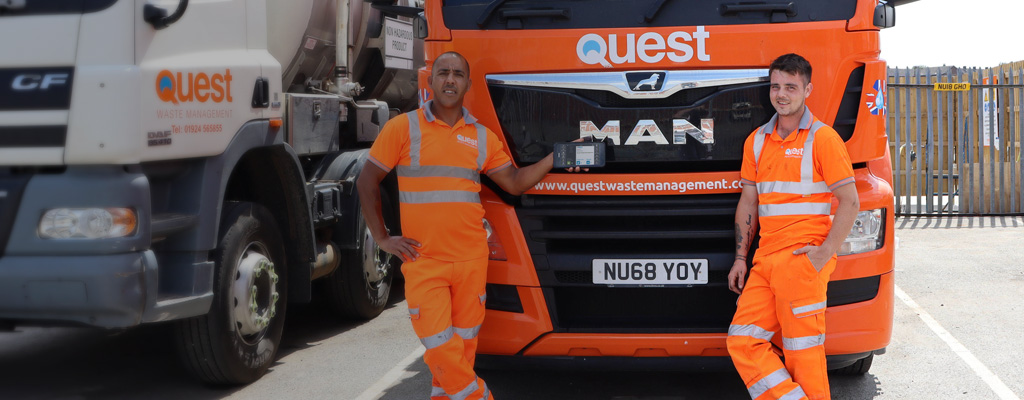 Quest workers infront of a truck
