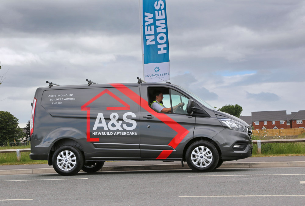 A&S Newbuild Aftercare employee driving a branded van
